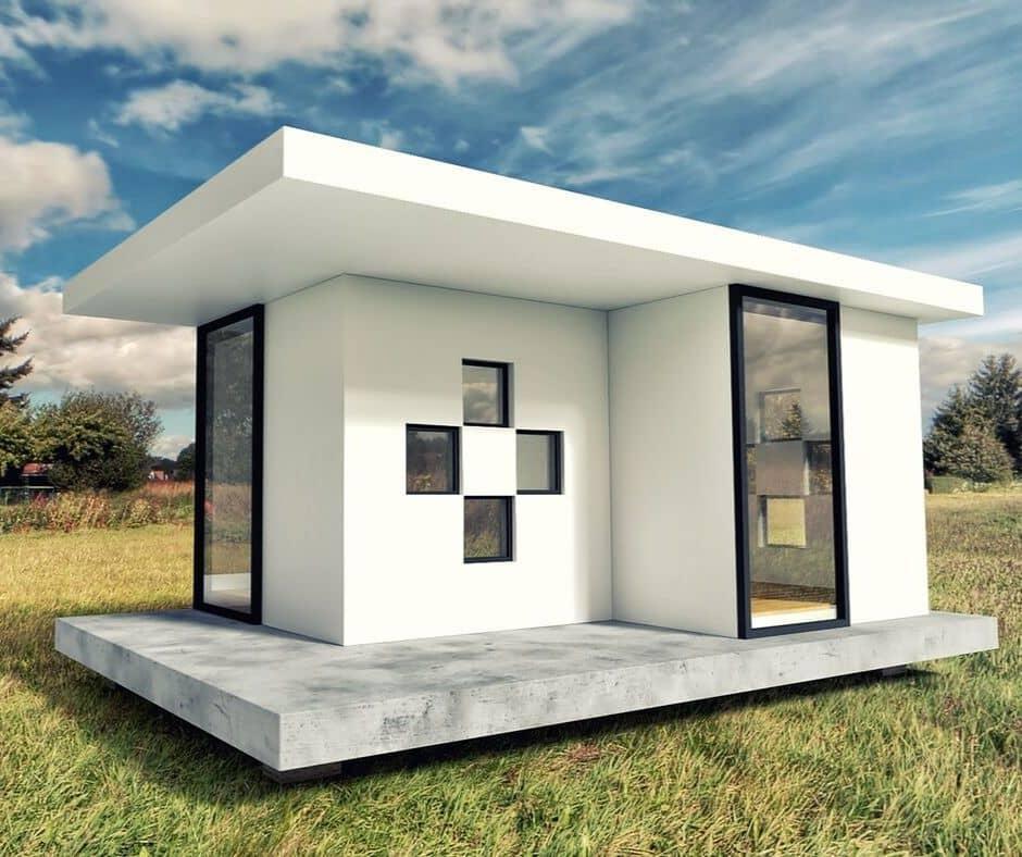 Ett modernt attefallshus med stora fönsterpartier.